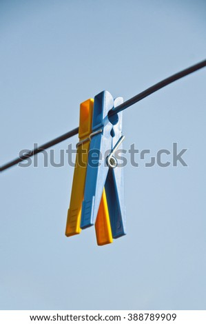 two clothespins on the rope