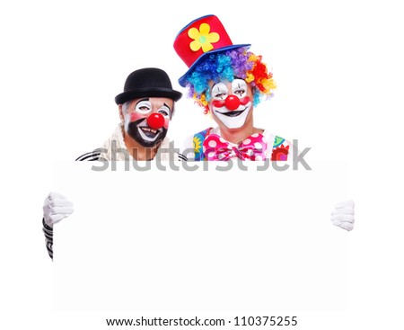 Two clowns holding the blank board - stock photo