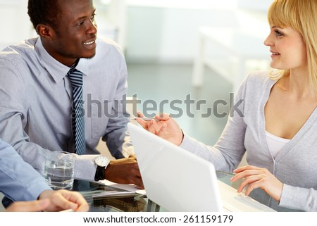 Two co-workers exchanging ideas - stock photo