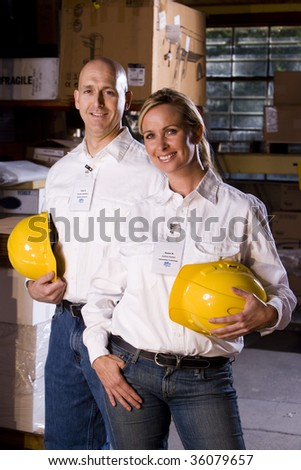 Two co-workers in office storage warehouse - stock photo