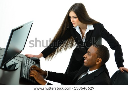 Two Co-workers Working as a Team - stock photo