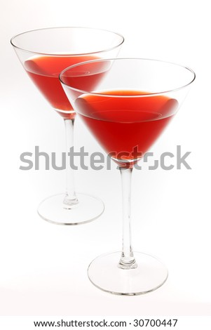 Two cocktail glasses with red liquid inside, isolated on white