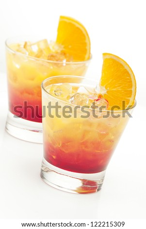 two cocktail tequila sunrise on a white