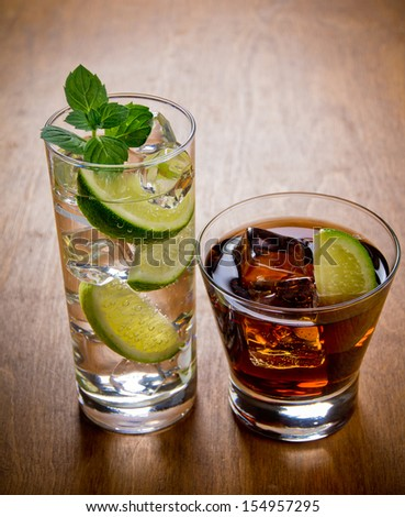 Two cocktails, cuba libre and gin and tonic - stock photo