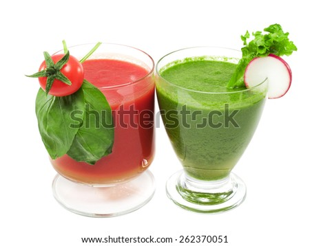 Two cocktails made of tomato and green salad isolated on white. Decorated with cherry tomato, basil, lettuce and radish slice