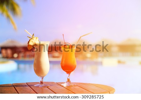 Two cocktails on luxury tropical beach resort - stock photo