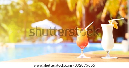 Two cocktails on luxury tropical beach resort, panorama - stock photo