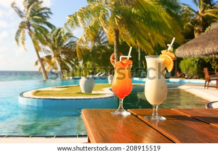 Two cocktails on  luxury tropical vacation - stock photo