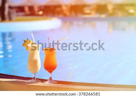 Two cocktails on tropical beach resort - stock photo