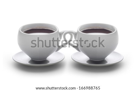 two coffee cups with braided handles  - stock photo