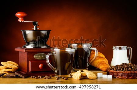 Two Coffee Cups with Grinder, sweets and milk