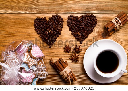 Two coffee heart on a wooden table - stock photo