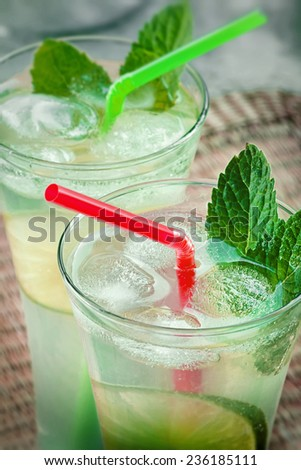 two cold mojitos - summer cocktail  - stock photo