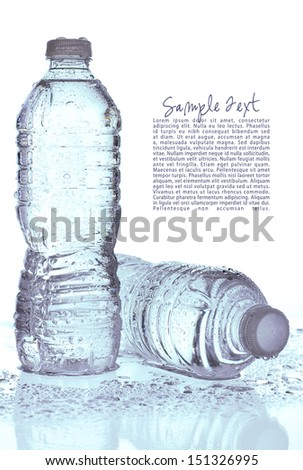 Two cold wet water bottles on white background with sample text and copy space. - stock photo