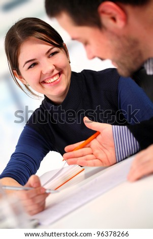 Two colleagues discussing in the office - stock photo
