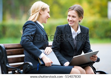 Two colleagues gathered together for discussing their work - stock photo