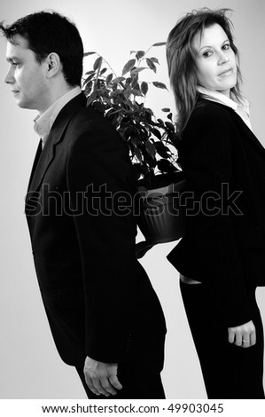 two colleagues holding pot - stock photo