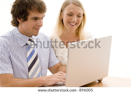 Two colleagues working on a laptop computer