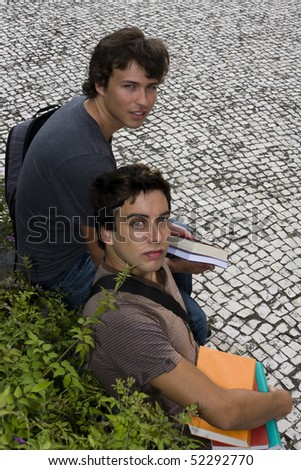 Two college or university students looking up - stock photo