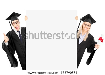 Two college students standing behind blank panel and gesturing success isolated on white background - stock photo