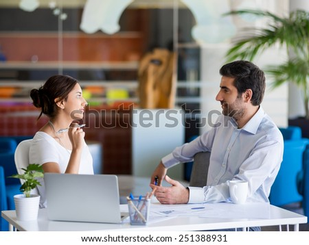Two collegues working together in an office - stock photo