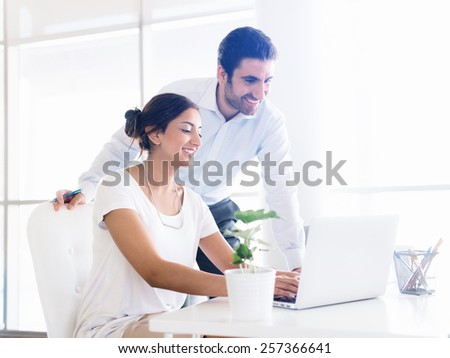 Two collegues working together in an office