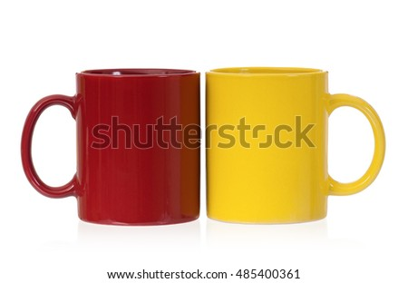 Two color coffee cups - red, green and blue, isolated on white background. Set of ceramic motley mugs for tea with clipping path.