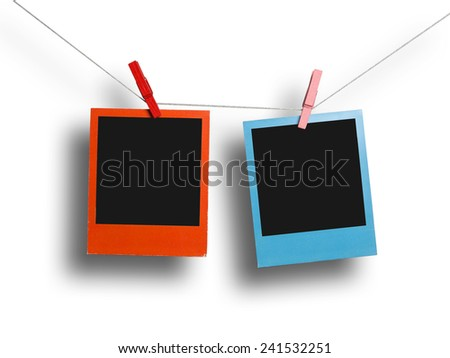 Two color photos on a clothesline - stock photo