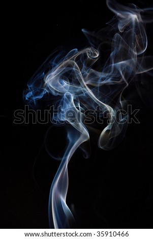 Two color smoke isolated on black background