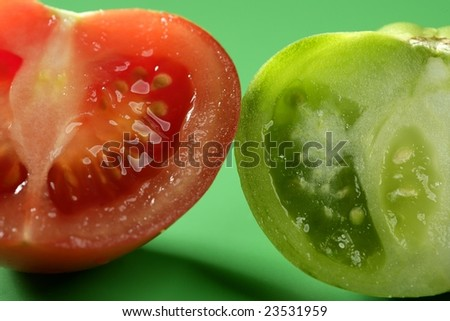 Two color tomatoes, green and red variety, studio shot