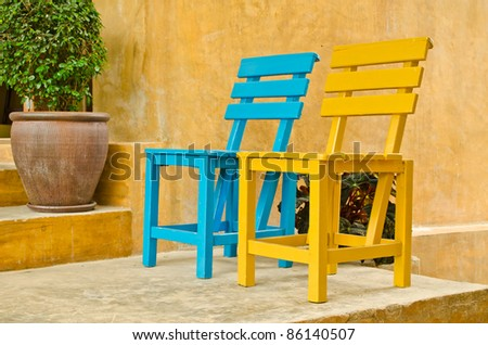 two color wood chairs in garden