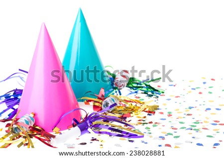 Two colorful birthday party hats with noisemakers and confetti on a white background