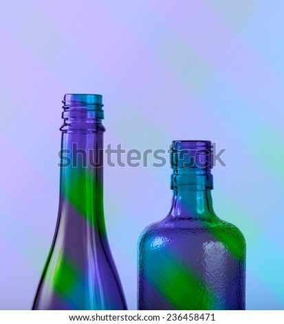 Two  colorful bottles on striped background