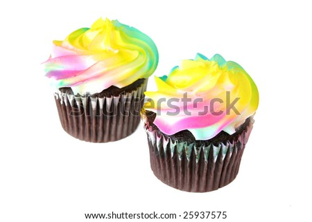 Two colorful cupcakes of chocolate shot on a white background.