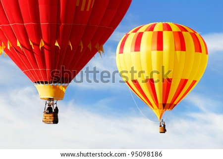 Two colorful hot air balloons floating in the sky at the Balloon Fiesta in Albuquerque, New Mexico, USA