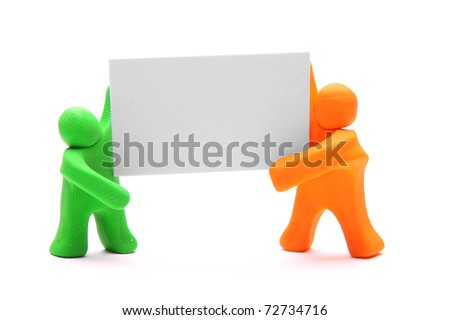 two colorful plasticine guys holding a blank poster - stock photo