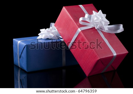 Two colorful presents on black background - stock photo
