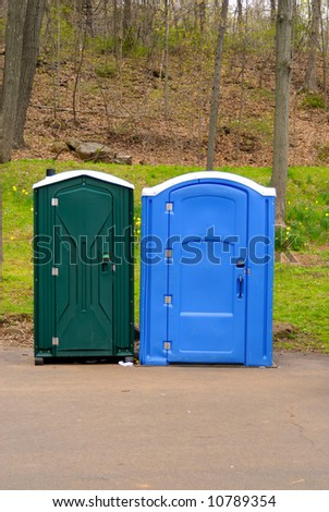Two colorful public toilets on a bright spring day - stock photo