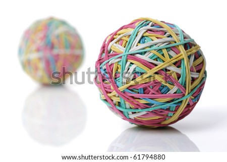 Two colorful rubber elastic band balls isolated on white - stock photo