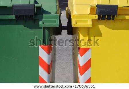 Two colorful rubbish bin detail - stock photo