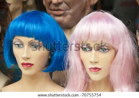 Two colorful wigs (blue and pink) in a wig store - stock photo