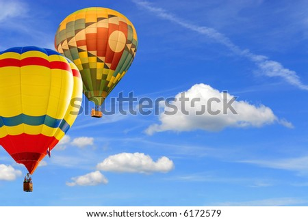 two colorfull hot air balloons floating in blue sky background - stock photo