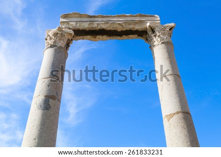 Two columns and portico fragment on blue sky background, ruined roman temple in Smyrna. Izmir, Turkey - stock photo