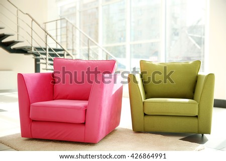 Two comfortable armchairs indoors - stock photo