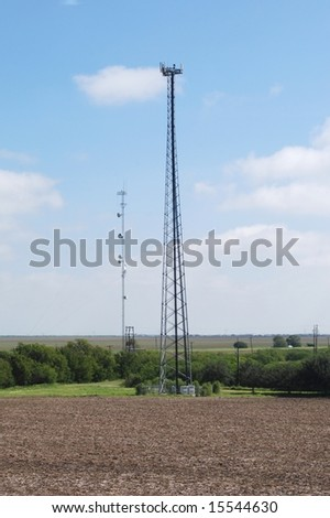 two communication towers - stock photo