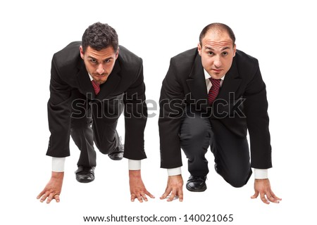 two competitive businessmen in starting position ready to run a race - stock photo