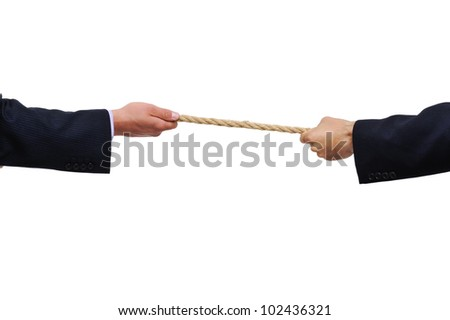 Two competitors pulling a rope - stock photo