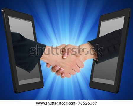 Two Computer Device and Hands in handshaking, Internet Working Concept, Wireless Communication, Online Business - stock photo