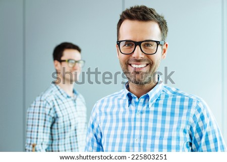 Two computer geeks standing in office - stock photo
