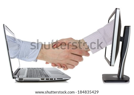Two computers  and hands in handshaking, internet working concept, wireless communication, on-line business - stock photo